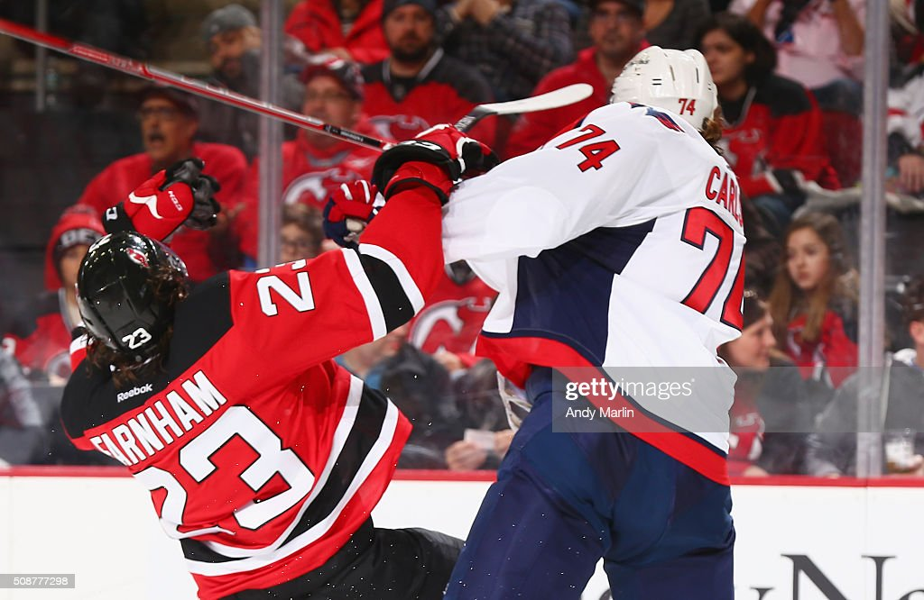 Bobby Farnham #23 of the New Jersey Devils and John Carlson #74 of the Washington Capitals come together during the game at the Prudential Center on February 6, 2016 in Newark, New Jersey.