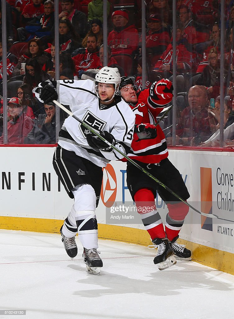Bobby Farnham #23 of the New Jersey Devils and Kevin Gravel #53 of the Los Angeles Kings battle for position during the game at the Prudential Center on February 14, 2016 in Newark, New Jersey.