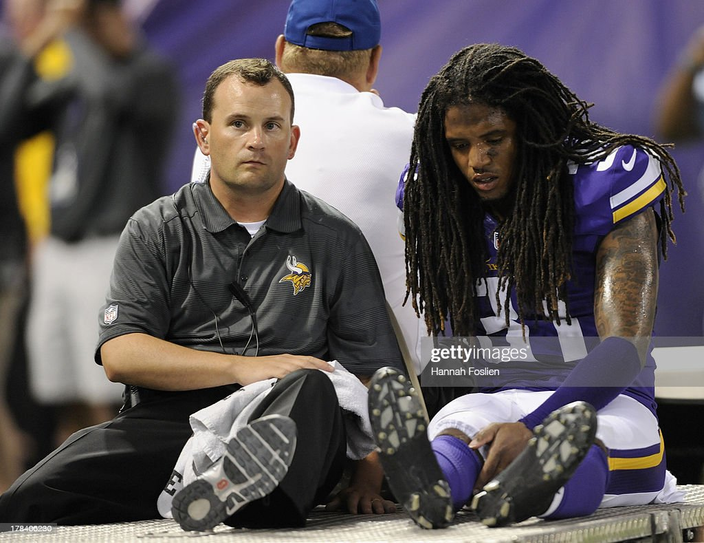 Bobby Felder #31 of the Minnesota Vikings is carted off the field at the end of the third quarter of the game against the Tennessee Titans on August 29, 2013 at Mall of America Field at the Hubert H. Humphrey Metrodome in Minneapolis, Minnesota. The Vikings defeated the Titans 24-23.