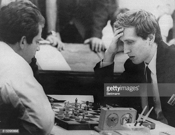 Bobby Fischer an eighttime US chess champion ponders his next move against world champion Boris Spassky in the sixth round of the 19th chess Olympiad...