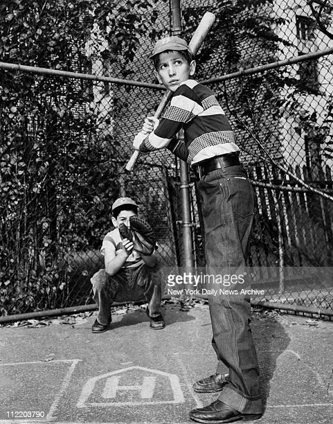 Bobby Fischer of 560 Lincoln Place knows how to move about home plate as a batter Playmate Johnny cohen is catching Fischer also knows how to make...