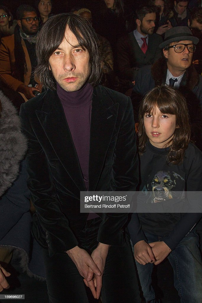 <a gi-track='captionPersonalityLinkClicked' href=/galleries/search?phrase=Bobby+Gillespie&family=editorial&specificpeople=572876 ng-click='$event.stopPropagation()'>Bobby Gillespie</a> (L) and his son attend the Givenchy Men Autumn / Winter 2013 show as part of Paris Fashion Week on January 18, 2013 in Paris, France.