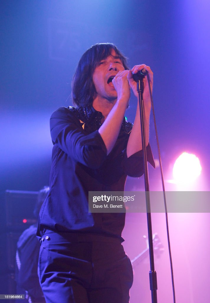 <a gi-track='captionPersonalityLinkClicked' href=/galleries/search?phrase=Bobby+Gillespie&family=editorial&specificpeople=572876 ng-click='$event.stopPropagation()'>Bobby Gillespie</a> of Primal Scream performs as Dazed & Confused presents Ray-Ban's 75th Anniversary celebration with Primal Scream and Kim Gordon of Sonic Youth at the Islington Assembly Hall on September 13, 2012 in London, England.