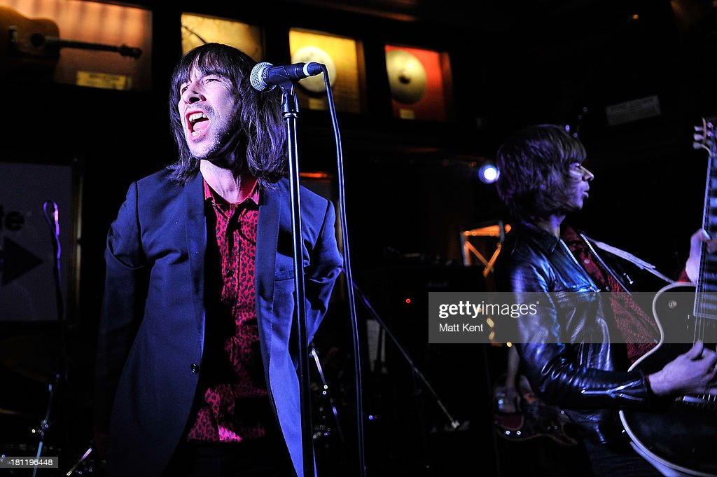 <a gi-track='captionPersonalityLinkClicked' href=/galleries/search?phrase=Bobby+Gillespie&family=editorial&specificpeople=572876 ng-click='$event.stopPropagation()'>Bobby Gillespie</a> (L) of Primal Scream performs as part of the Absolute Radio Sessions at Hard Rock Cafe, Old Park Lane on September 19, 2013 in London, England.
