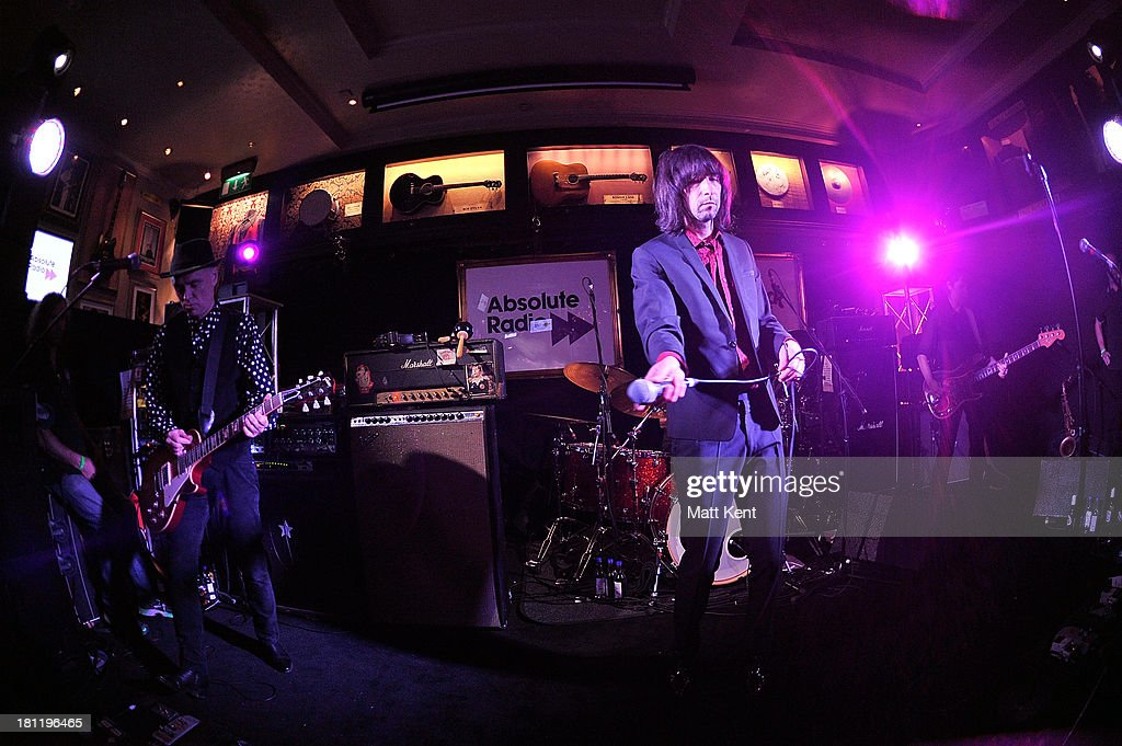 <a gi-track='captionPersonalityLinkClicked' href=/galleries/search?phrase=Bobby+Gillespie&family=editorial&specificpeople=572876 ng-click='$event.stopPropagation()'>Bobby Gillespie</a> (C) of Primal Scream performs as part of the Absolute Radio Sessions at Hard Rock Cafe, Old Park Lane on September 19, 2013 in London, England.