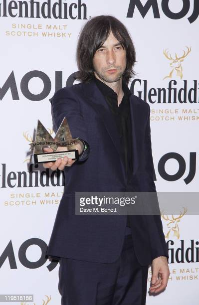 Bobby Gillespie of Primal Scream poses in front of the winners boards with the band's MOJO Classic Album Award at the Glenfiddich Mojo Honours List...