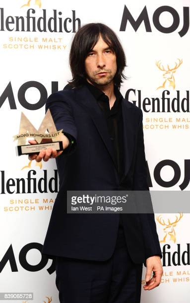 Bobby Gillespie of Primal Scream wins the Mojo Classic Album Award at the Mojo Awards at the Brewery in London