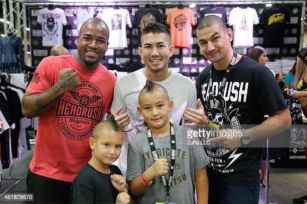 Bobby Green Louis Smolka and Vinc Pichel pose with fans during the UFC Fan Expo 2014 during UFC International Fight Week at the Mandalay Bay...