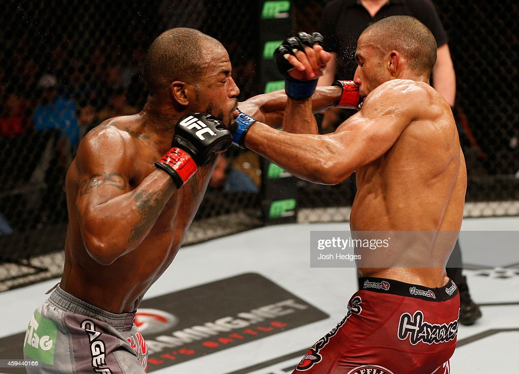 Bobby Green punches Edson Barboza of Brazil in their lightweight bout during the UFC Fight Night event at The Frank Erwin Center on November 22, 2014 in Austin, Texas.