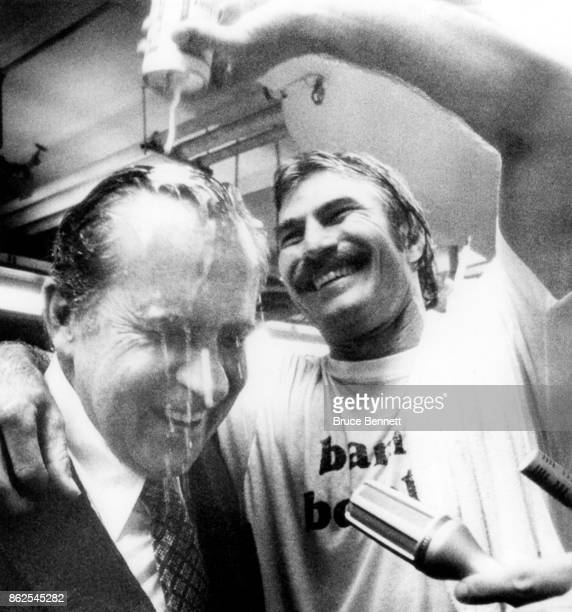 Bobby Grich of the California Angels pours beer over former President Richard Nixon after the Angels defeated the Kansas City Royals to win the...