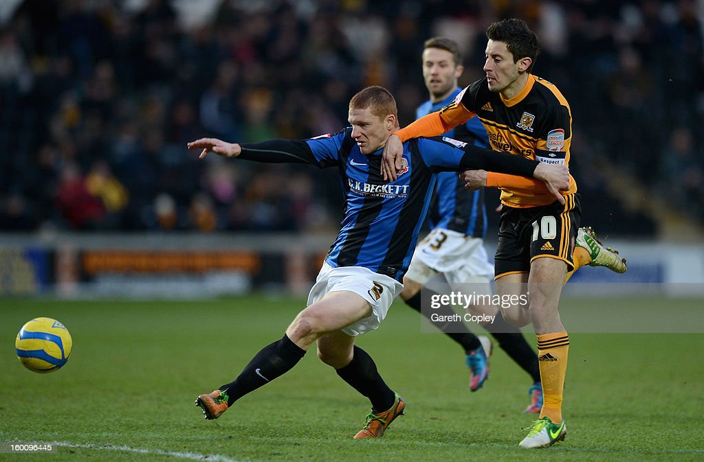 Bobby Hassell of Barnsley holds off <a gi-track='captionPersonalityLinkClicked' href=/galleries/search?phrase=Robert+Koren&family=editorial&specificpeople=740564 ng-click='$event.stopPropagation()'>Robert Koren</a> of Hull City during the FA Cup Fourth Round between Hull City and Barnsley at KC Stadium on January 26, 2013 in Hull, England.