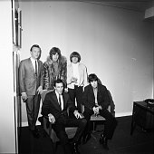 Bobby Hatfield and Bill Medley of The Righteous Brothers with Mick Jagger Brian Jones and Keith Richards of the Rolling Stones backstage London 1965