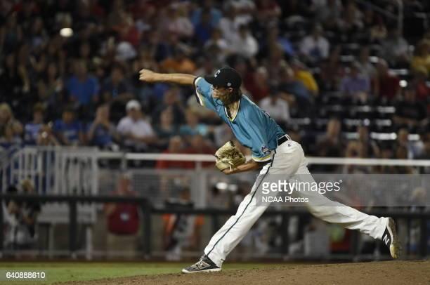 Bobby Holmes of Coastal Carolina University delivers a pitch against the University of Arizona during the Division I Men's Baseball Championship held...