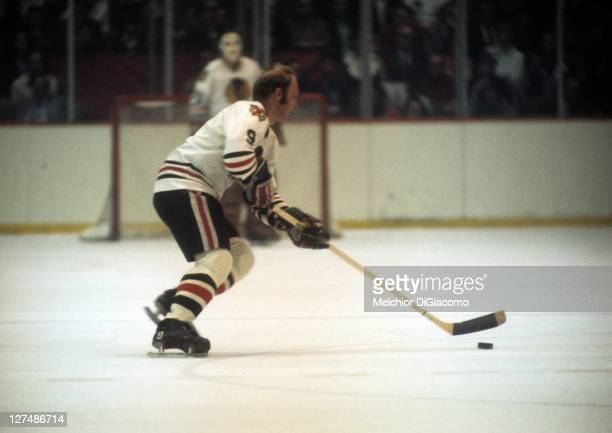 Bobby Hull of the Chicago Blackhawks skates with the puck during an NHL game circa 1971 at the Chicago Stadium in Chicago Illinois