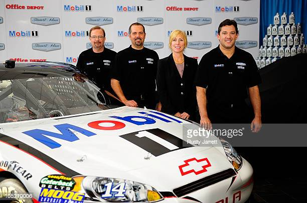 Bobby Hutchens Director of Competition Darian Grub crew chief Rebecca Rahaim Mobil 1 Global Brand Manager and Tony Stewart StewartHaas Racing's...