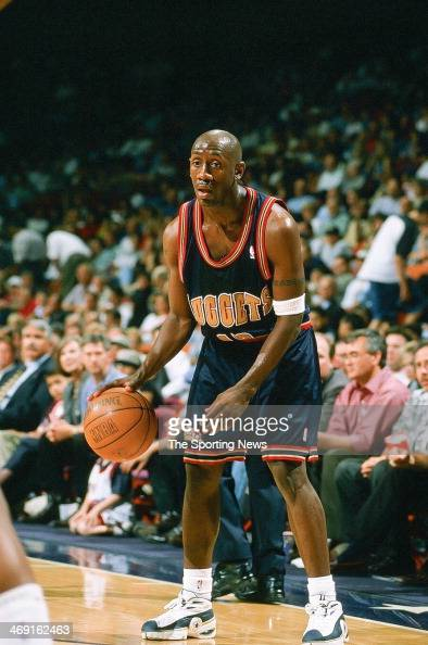 bobby-jackson-of-the-denver-nuggets-moves-the-ball-during-the-game-picture-id469162463?s=594x594
