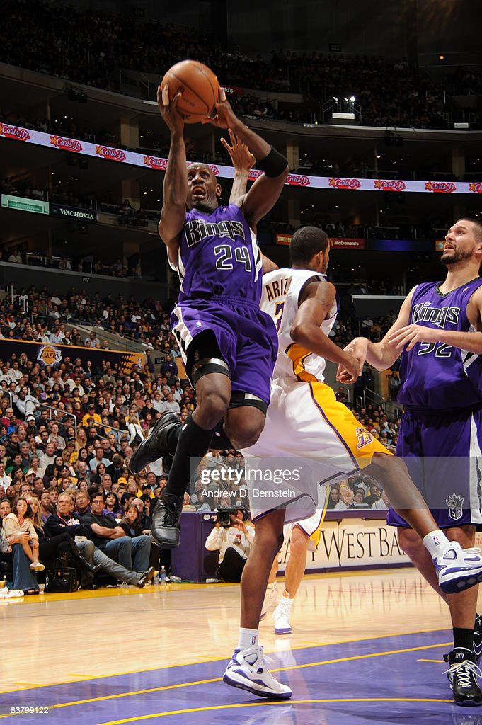 Bobby Jackson #24 of the Sacramento Kings puts up a shot against Trevor Ariza #3 of the Los Angeles Lakers at Staples Center on November 23, 2008 in Los Angeles, California.