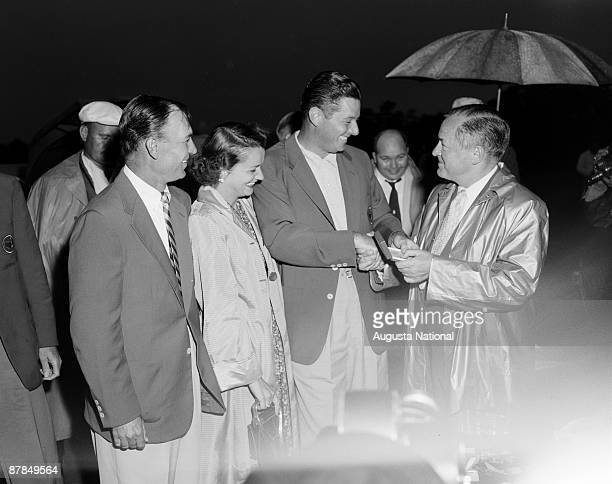 Bobby Jones congratulates Masters Winner Cary Middlecoff as Ben Hogan looks on after the 1955 Masters Tournament at Augusta National Golf Club on...