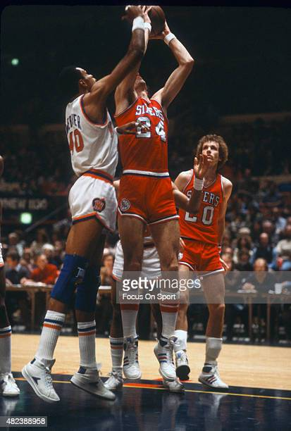 Bobby Jones of the Philadelphia 76ers battles for a rebound with Marvin Webster of the New York Knicks during an NBA basketball game circa 1978 at...