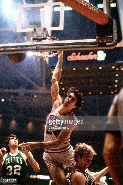 Bobby Jones of the Philadelphia 76ers dunks against Larry Bird of the Boston Celtics in a 1981 season game at the Spectrum in Philadelphia...