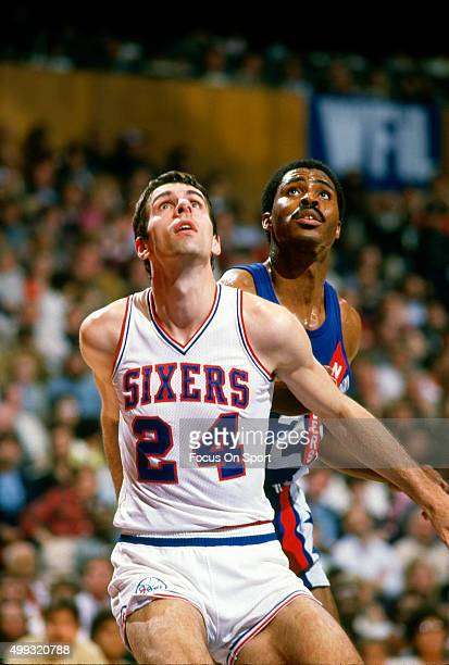 Bobby Jones of the Philadelphia 76ers works for position on Buck Williams of the New Jersey Nets during an NBA basketball game circa 1984 at The...