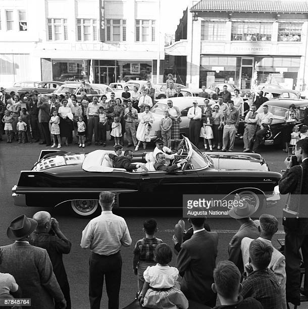 Bobby Jones rides in an open car during the annual Masters Parade April 1959 in downtown Augusta Georgia
