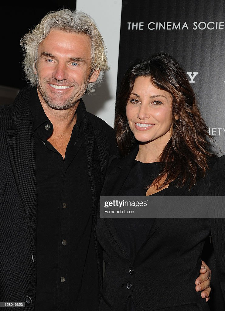 Bobby Kaiser and actress Gina Gershon (R) attend The Cinema Society With Chrysler & Bally Host The Premiere Of 'Stand Up Guys' at MOMA on December 9, 2012 in New York City.