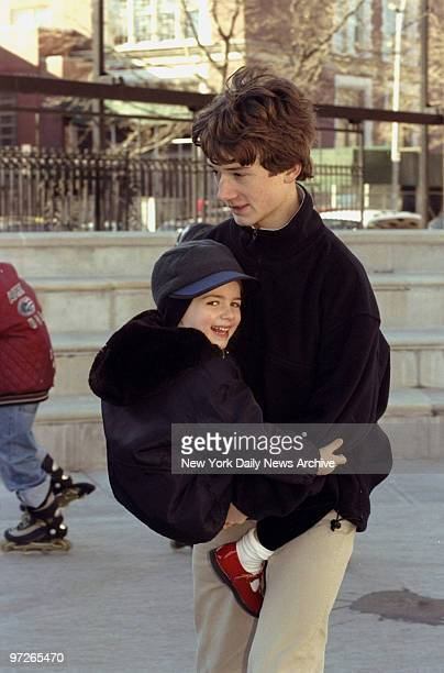 Bobby Kennedy son of Robert F Kennedy Jr holds his brother Finn while rollerskating at the 34th annual Robert F Kennedy memorial holiday party The...
