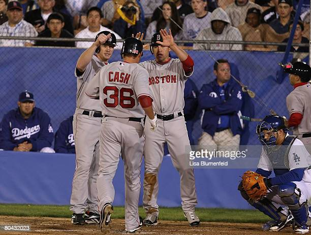 Bobby Kielty and Jacoby Ellsbury congratulate teammate Kevin Cash of the Boston Red Sox after hitting a three run homerun in the second innng against...