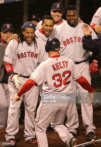 Bobby Kielty of the Boston Red Sox celebrates with teammates David Ortiz and Manny Ramirez after hitting a solo home run against the Colorado Rockies...