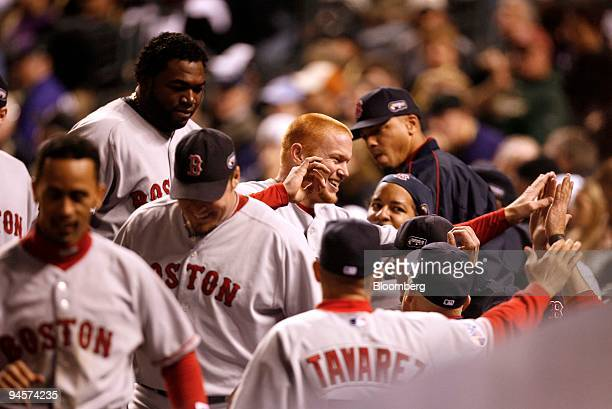 Bobby Kielty of the Boston Red Sox center with reddish hair is congratulated by teammates after hitting a solo home run against the Colorado Rockies...