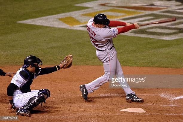 Bobby Kielty of the Boston Red Sox hits a solo home run against the Colorado Rockies during Game 4 of the Major League Baseball World Series at Coors...
