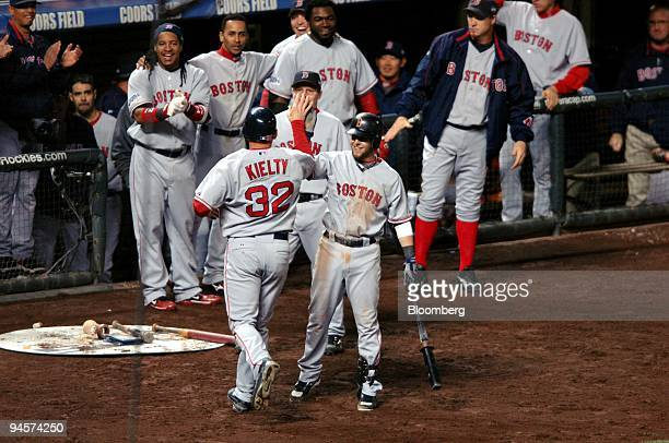 Bobby Kielty of the Boston Red Sox No 32 is congratulated by teammates after hitting a solo home run against the Colorado Rockies during Game 4 of...