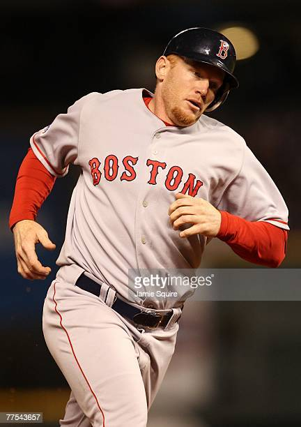 Bobby Kielty of the Boston Red Sox rounds the bases after hitting a solo home run in the eighth inning against the Colorado Rockies during Game Four...