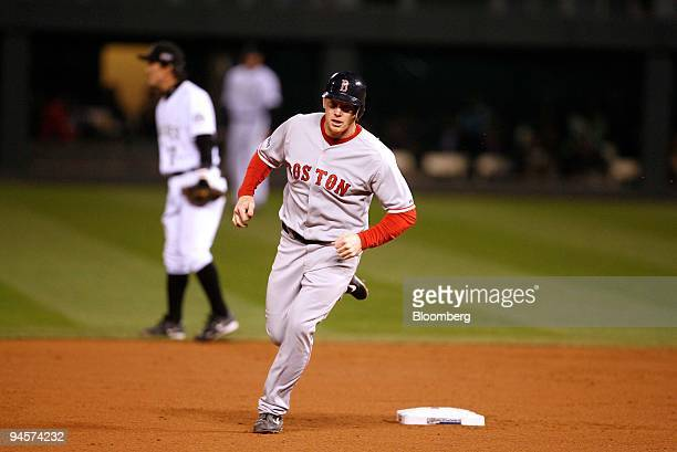 Bobby Kielty of the Boston Red Sox rounds the bases after hitting a solo home run against the Colorado Rockies during Game 4 of the Major League...