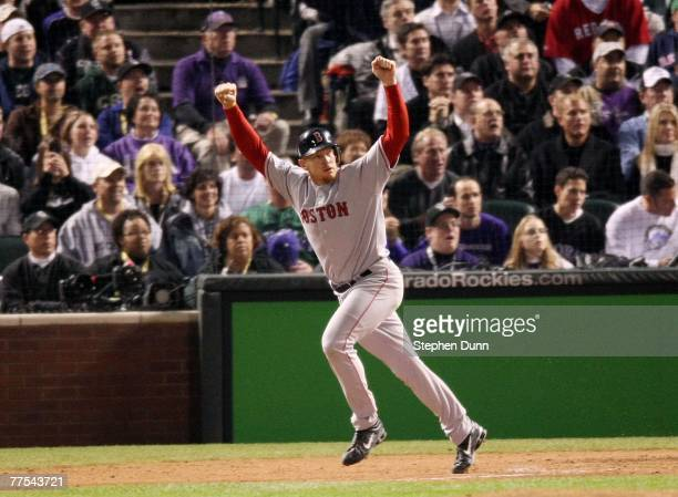 Bobby Kielty of the Boston Red Sox watches a solo home run in the eighth inning against the Colorado Rockies during Game Four of the 2007 Major...