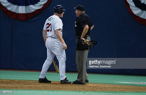 Bobby Kielty of the Minnesota Twins ardues a third strike call with umpire Mike Everitt to end the eighth inning against the Anaheim Angels during...