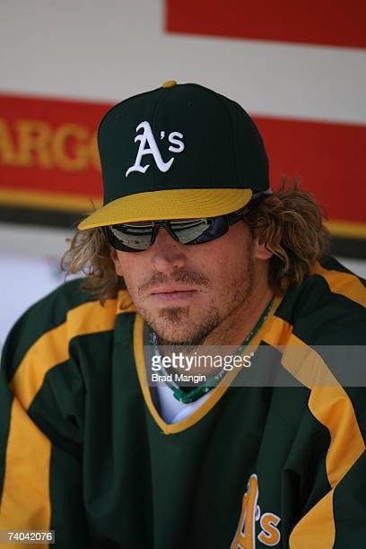 Bobby Kielty of the Oakland Athletics sits in the dugout prior to the game against the New York Yankees at McAfee Coliseum in Oakland California on...