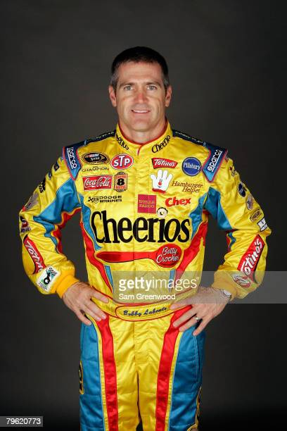 Bobby Labonte driver of the Cheerios/Betty Crocker Dodge poses for a photo during the NASCAR Sprint Cup Series media day at Daytona International...