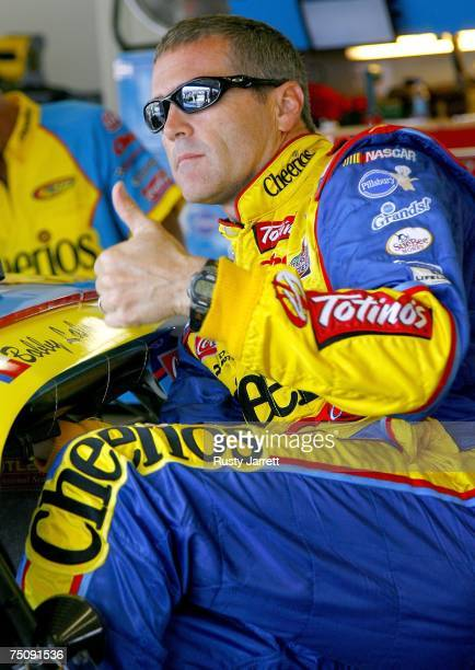 Bobby Labonte driver of the Cheerios/Pillsbury Cinnabon Dodge stands in the garage before practice for the NASCAR Nextel Cup Series Pepsi 400 at...