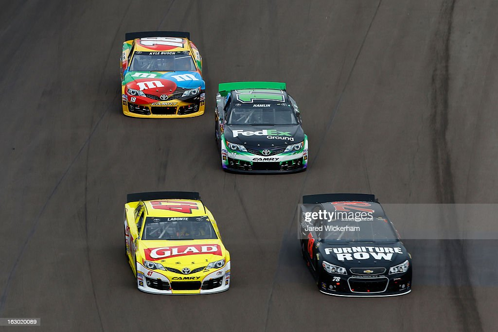 Bobby Labonte driver of the Glad Toyota Kurt Busch driver of the Furniture Row/Beautyrest Chevrolet Denny Hamlin driver of the FedEx Ground Toyota...