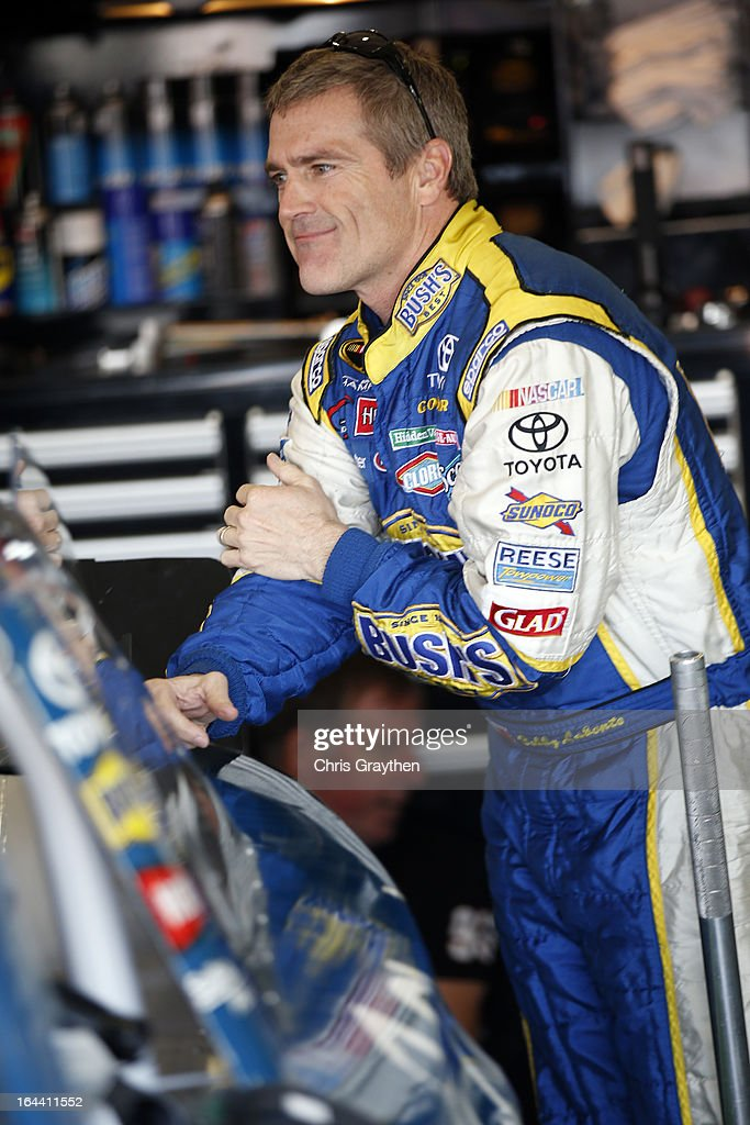 Bobby Labonte, driver of the #47 Kroger Toyota, stands in the garage area during practice for the NASCAR Sprint Cup Series Auto Club 400 at Auto Club Speedway on March 23, 2013 in Fontana, California.