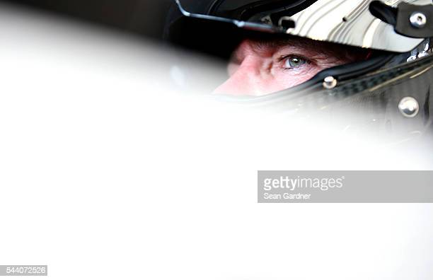 Bobby Labonte driver of the OneOrlando Fund Ford sits in his car during practice for the NASCAR Sprint Cup Series Coke Zero 400 at Daytona...