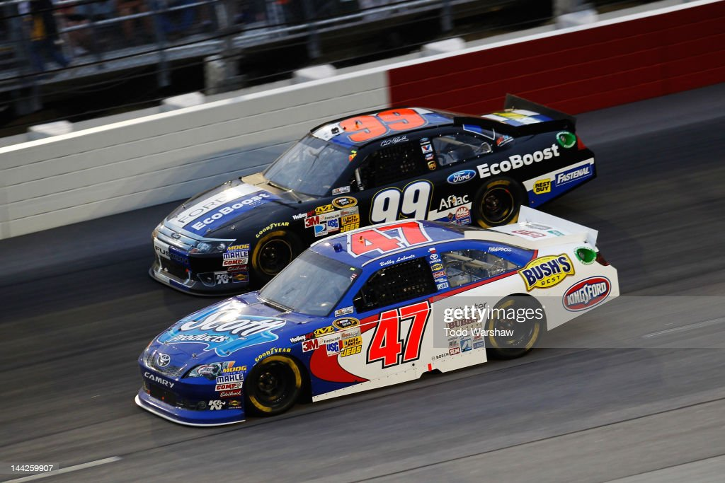 Bobby Labonte, driver of the #47 Scott Products Toyota, races Carl Edwards, driver of the #99 Roush Fenway Racing Ford, during the NASCAR Sprint Cup Series Bojangles' Southern 500 at Darlington Raceway on May 12, 2012 in Darlington, South Carolina.