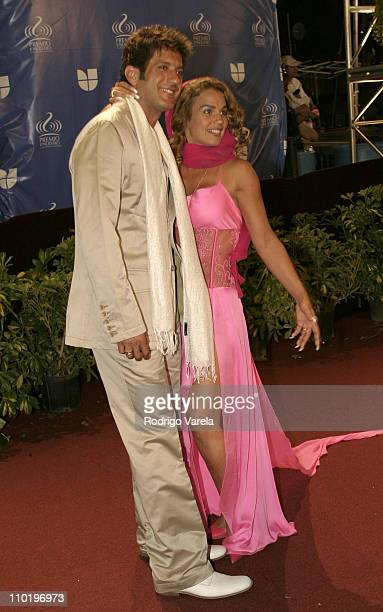 Bobby Larios and Niurka Marcos during 2004 Premio Lo Nuestro Arrivals at Miami Arena in Miami Florida United States