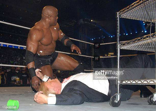 Bobby Lashley kneels over a fallen Donald Trump after the 'Billionaire' was on a receiving end of a Stone Cold Stunner by special referee Steve...