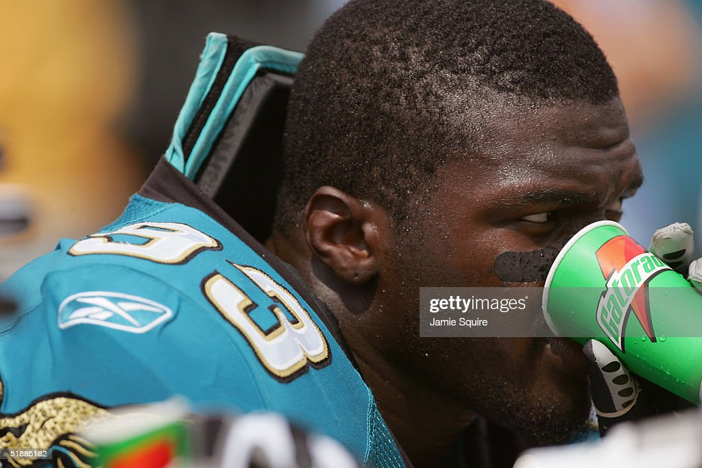 Bobby McCray #93 of the Jacksonville Jaguars takes a drink during the first half of the game against the Indianapolis Colts at Alltel Stadium on October 3, 2004 in Jacksonville, Florida.