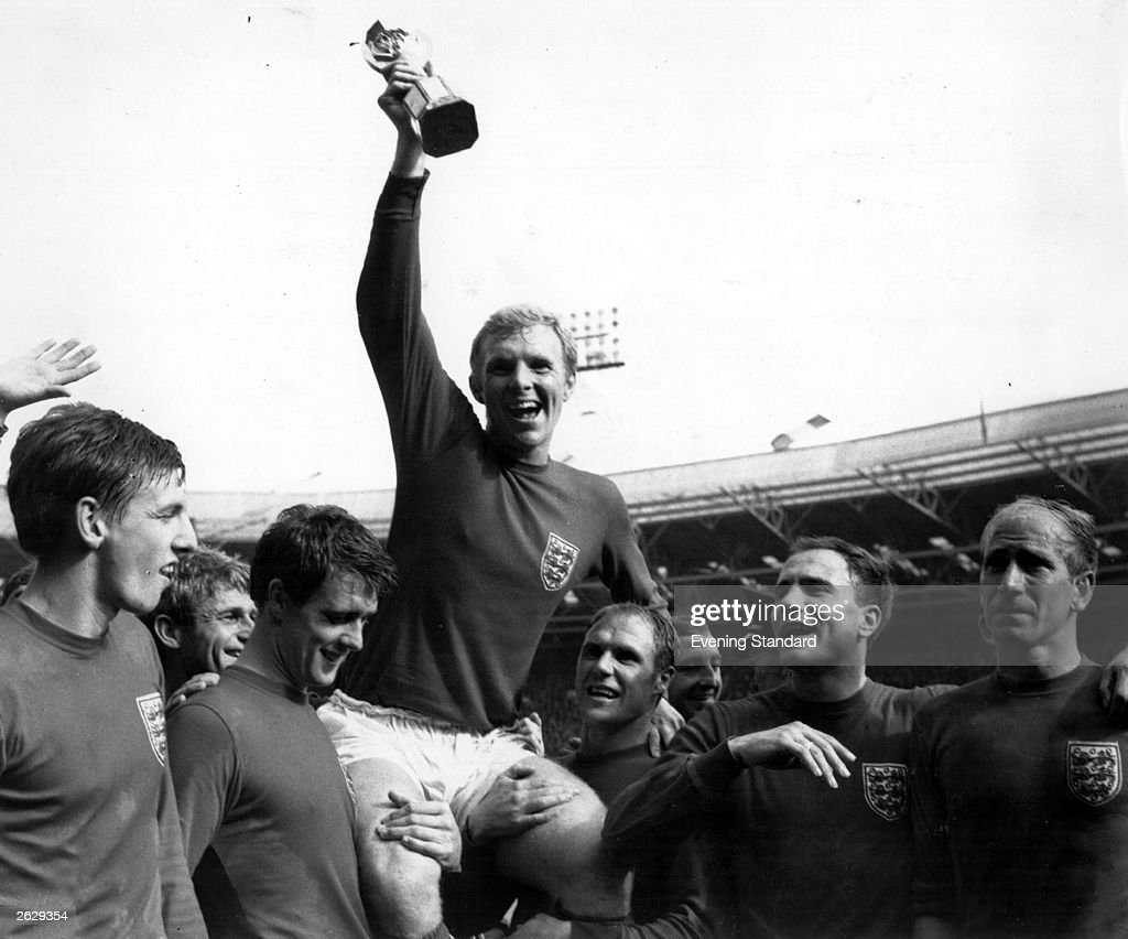 Bobby Moore supported by his team mates holds up the Jules Rimet trophy after England's victory in the World Cup Final beating West Germany 42 after...