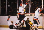 Bobby Nystrom John Tonelli and Butch Goring of the New York Islanders celebrate Nystrom's overtime gamewinning goal in Game 5 of their divisional...