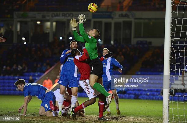 Bobby Olejnik of Peterborough United saves from Nile Ranger of Swindon Town during the Johnstone's Paint Southern Area Final between Peterborough...